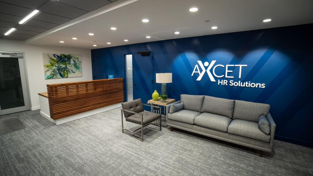 Axcet HR solutions graphic logo wall in waiting area
